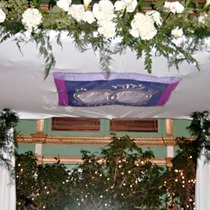 Chuppah with Removable Panel - The center panel of this chuppah was attached temporarily for the wedding ceremony, then removed and given to the couple as a wall-hanging for their new home. (See next picture for detail)