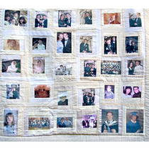 Wedding Quilt - This display quilt commemorates a wedding and includes childhood and family photographs of the couple, as well as pictures from the wedding day itself and pieces of lace from the bride's dress.